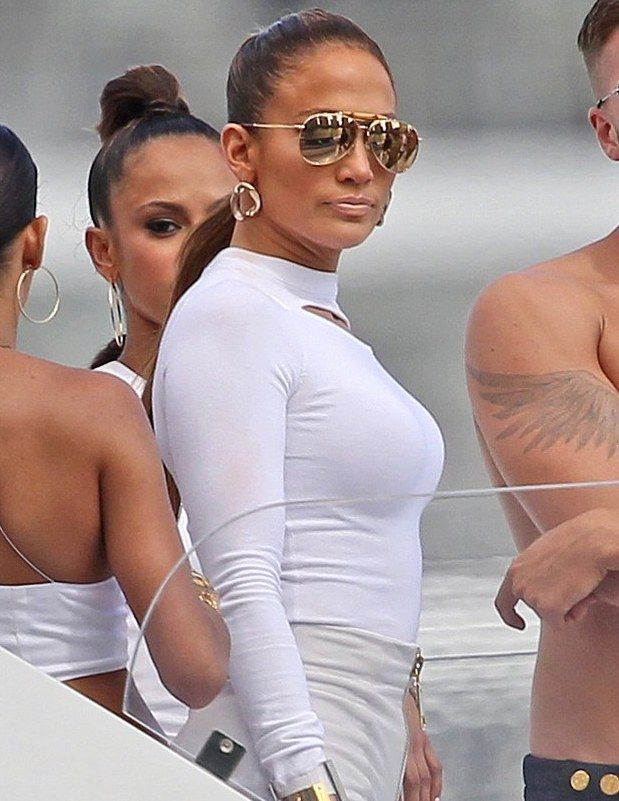 Jennifer Lopez beams in white and reflective lenses while filming a video for her new single I Luh Ya Papi