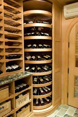 I could see the corner lazy susan shelf for a shoe rack? Ceiling height wine wheels can store hundreds of bottle in this cellar's corner.