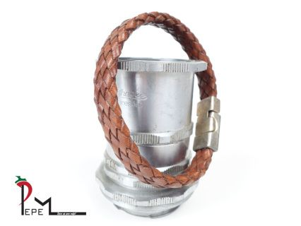 An brown leather bracelet with a diameter of 21 cm or 8.2 inches. The closure is made of magnetic metal with a vintage coating.