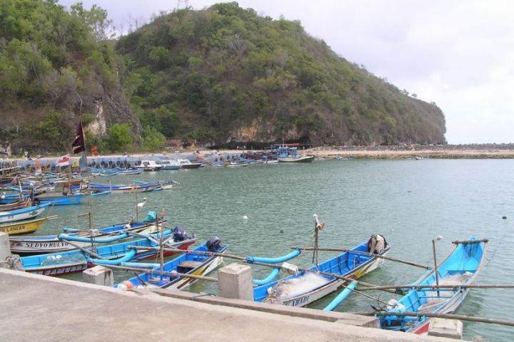 blue boats at sadeng beach yogyakarta indonesia