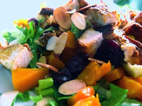 Moroccan Chicken Salad with golden beets, butternut squash, almonds, cherries, and a citrus avocado dressing