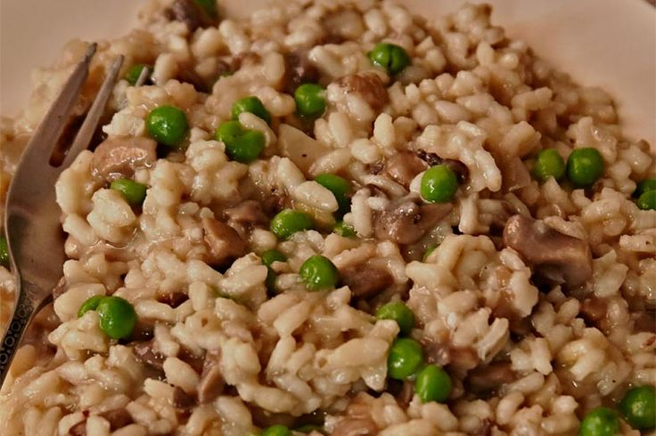 Dairy-free Risotto with Mushrooms and Peas by Giada De Laurentiis | Arborio rice releases starch as it cooks, creating a creamy consistency even without the addition of dairy. Peas and mushrooms add earthy and fresh notes to this naturally gluten-free, vegan dish.