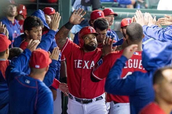 Apr 27, 2015; Arlington, TX, USA; Texas Rangers designated hitter Prince Fielder (84) is congratulated by his team after scoring during the fourth inning against the Seattle Mariners at Globe Life Park in Arlington. Mandatory Credit: Jerome Miron-USA TODAY Sports