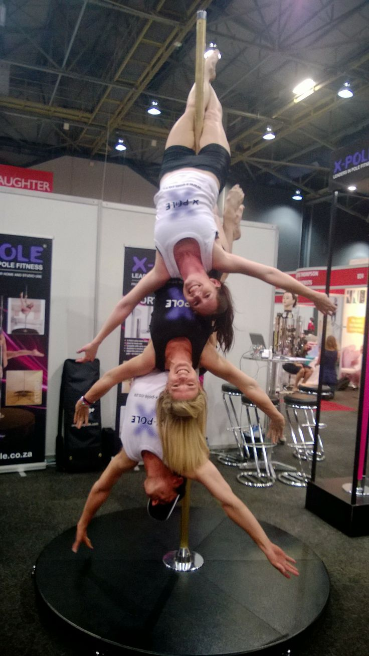 X-Pole dancers, Bronwyn, Sarah and Trevor inverting on the 45mm chrome X-Stage lite!