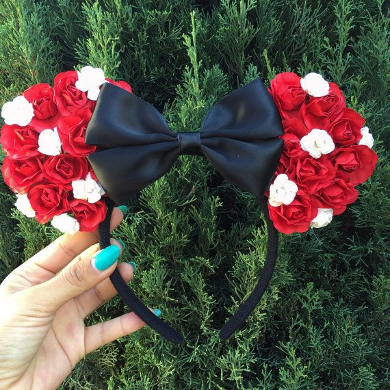 Large red paper roses with small white roses along with a beautiful black satin bow. Please let me know at checkout what color bow you would like :) ** DO NOT LEAVE YOUR MOUSE EARS IN HOT CAR FOR A LONG PERIOD OF TIME. THE GLUE WILL MELT AND THE EARS WILL DETACH. THE HEAT NOWADAYS HAVE BEEN OVERWHELMING***