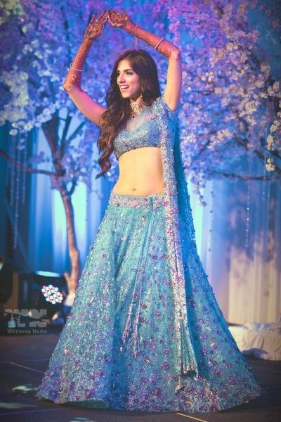 ice blue fairytale lehenga with intricate embroidery, shimmery, glistening, short blouse, soft waves in hairstyle, blue and purple, A line, flowy, georgette