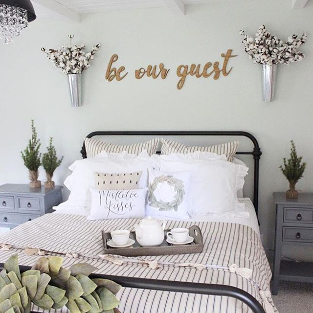 "The last two days have been filled with Magnolia dreams!  Check out my stories to see a bit of what we experienced!  After a couple of long days making our way around Waco this gorgeous guest bedroom of Farren's @prettypeachtree looks soooo inviting!  She is my pick this week for #wednesdaywalldecor I love every detail from the iron bed to the beautiful chandy!  Her ""be our guest"" sign is just perfection to welcome anyone to this gorgeous room! . . . #guestroom #farmhousestyle…"