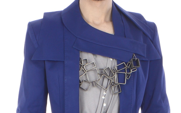 Detail: jacket ( cotton), draped top ( cotton jersey), jewellery piece ( metal, removeable)