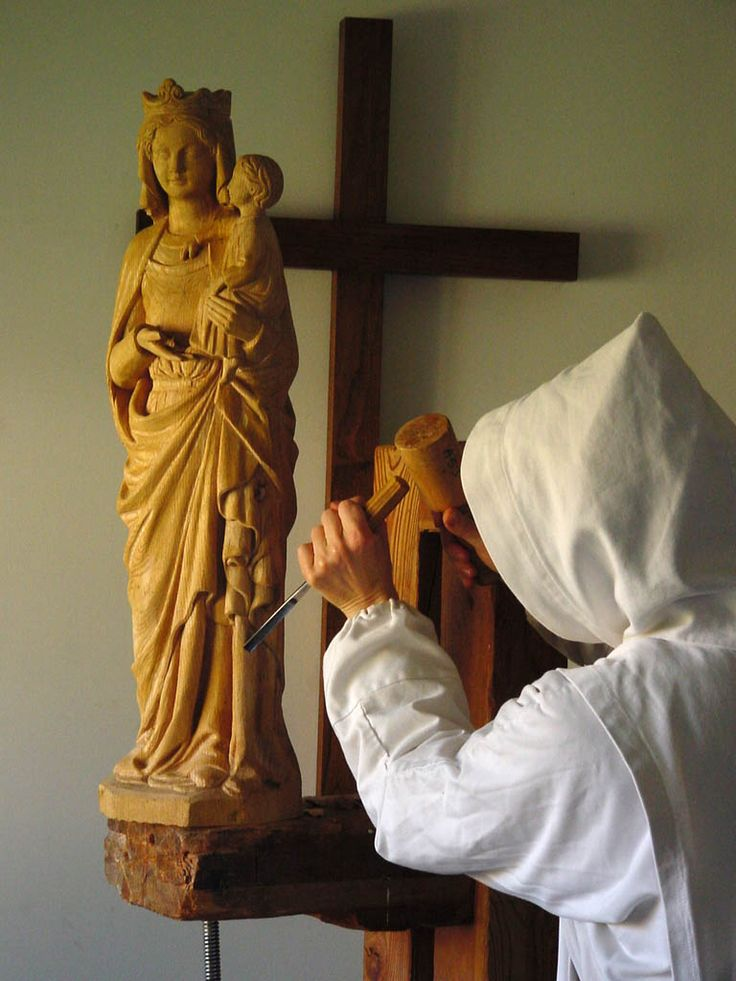 A monk carving