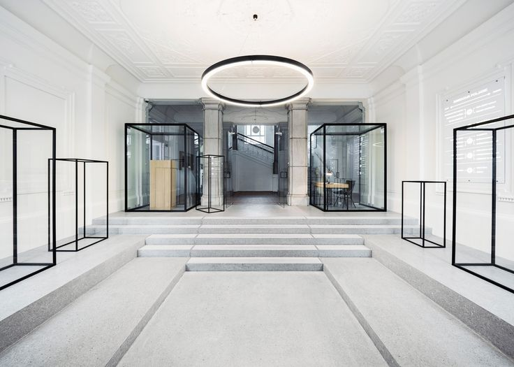 Solvenian firm Svet Vmes Architects has renovated the entrance hall of a 126-year-old school in Ljubljana, adding glass cabinets that resemble line drawings