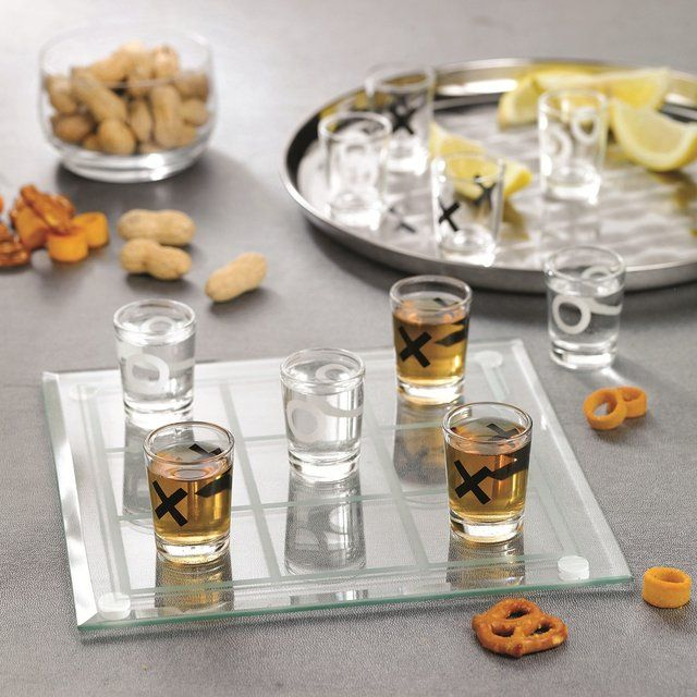 Tic-tac-toe, three in a row! A favorite pastime with an exciting twist, this fun drinking game calls for serious strategy, smooth shots, and great entertainment. Ideal for four players in pairs or just two individuals, this adult party game is sure to liven up any get together and keep the good times...ticking!2 Player Drinking Game set contains 8 x 8 etched glass playing board with rubber corner-pads and nine, 2, 1 oz. shot glasses. Always play responsibly.