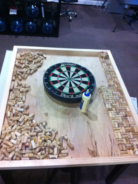 Custom dart board frame with wine cork backing, located in our design studio for brainstorming meetings at www.sixhalfdozen.com