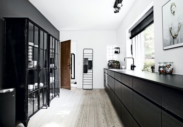 Mano by Kvik. Cool black Mano Sera kitchen from Kvik.com. Black laminate worktop. Glass cabinets from Nordal. Click to see full story and more photos from this amazing house.