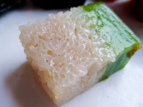 Kue Lapis Ketan - Jakarta, Indonesia.    Coconut-milk soaked sticky rice with a layer of pandan flavor on top. A popular traditional Indonesian dessert.