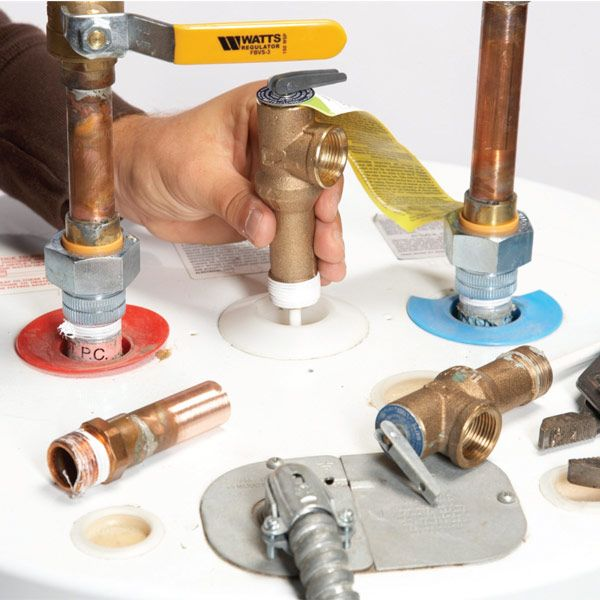 A puddle of water near the overflow tube can be a sign of a bad temperature-pressure relief valve. We'll show you how to replace it and add an expansion tank if the relief valve doesn't solve the problem.