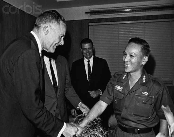 Saigon. Henry Cabot Lodge, U.S. Ambassador-Designate to South Vietnam (left), greeted by Major General Nguyen Van Thieu, Chairman of Vietnamese Directory. Mr. Lodge was on a fact finding trip, surveying economic, political, and military situations. 1965
