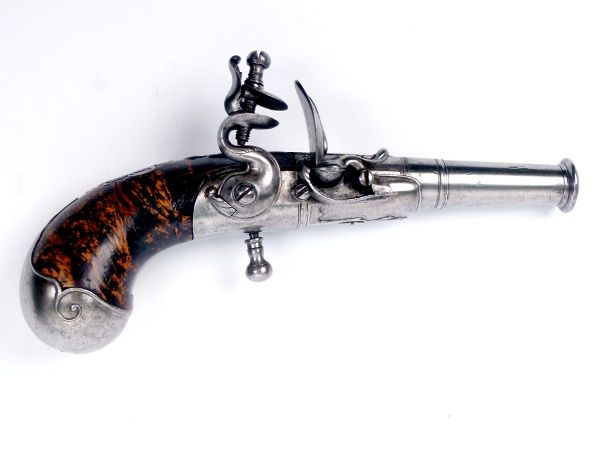 Flintlock Pistol has a rifled turn-off barrel. It predates Queen Anne`s reign, which began on March 8th 1702. The pistol was once exhibited at the Metropolitan Museum of Art in the early 1970s.