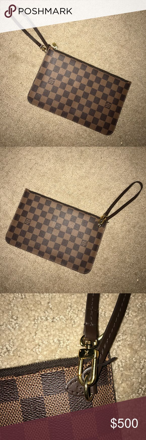 Louis Vuitton clutch Came inside of my Neverfull Damier Bag. Purchased from original Louis Vuitton store in Paris about 3 years ago. I took this out of my bag in the beginning, and only used this one time! It is in absolute perfect condition! Louis Vuitton Bags Clutches & Wristlets