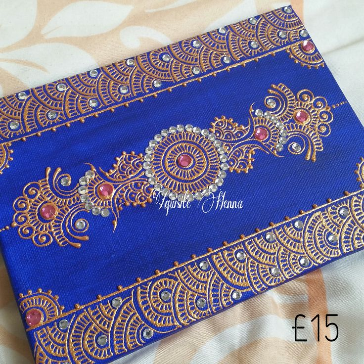 Blue canvas decorated with a chakra design using gold paint and silver/ fuchsia crystals. Only £15 (plus p&p)