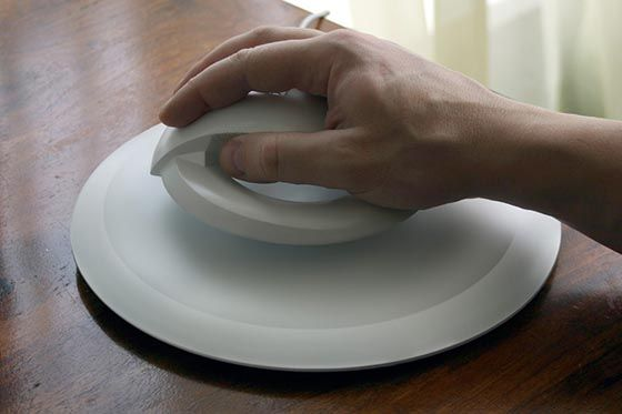 BAT: Unusual Levitating Wireless Computer Mouse - designed to help prevent carpal tunnel - designed by Kibardindesign Studio - floating mouse with magnet ring hovers over mouse pad base.