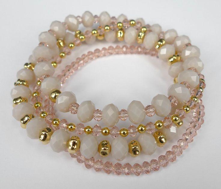 Skønne elastikarmbånd i pudder/rosa farver med lidt 'guld'.