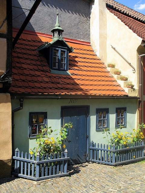 "One of the picturesque, brightly painted ""alchemist's"" cottages at Golden Lane, Prague Castle."
