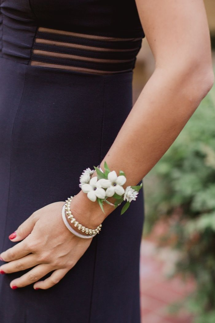 Bridesmaid's Corsage of Stephanotis Blossoms | Photo: Shaun Menary Photography. View More:  http://www.insideweddings.com/weddings/modern-black-and-white-wedding-with-southern-traditions-in-dallas/916/