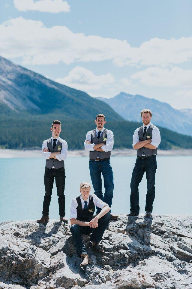 groom & groomsmen on the shores of Abraham Lake near Nordegg
