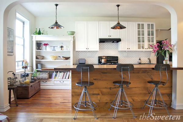 Brooklyn kitchen features pendant lamps crafted by Robert Ogden, wooden bartop made of reclaimed pine, and a new backspash in Merola Lantern tiles.