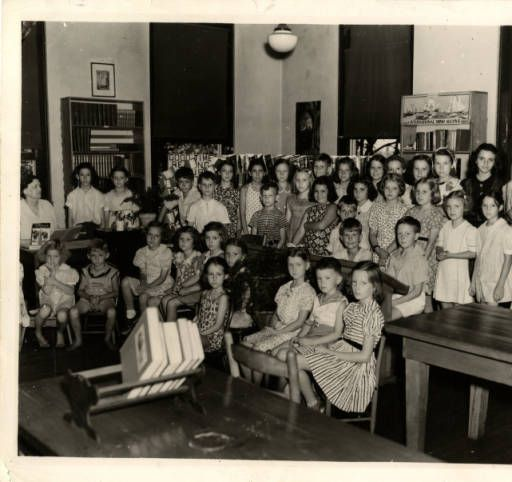 "Children's event at Union County's ""courthouse"" library is well attended :: Library History Collection.  Our library began in 1930 in a corner upstairs room of the now historic Union County [NC] courthouse.  This photo was from around 1940. #LibraryHistoryUCPL #ucplholding (the library owns the original photo)"
