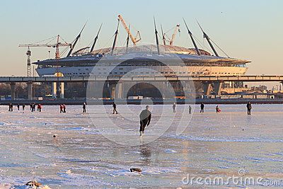 People are on vacation on the ice of the Neva Bay under construction next to the stadium Zenit-Arena on the first day of the new year . Saint-Petersburg, Russia