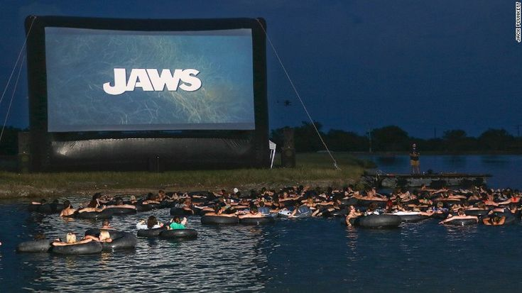 """The Alamo Drafthouse invites brave movie goers to view Steven Spielberg classic """"Jaws,"""" which turns 40 this year, on a giant screen as they float in inner tubes over murky waters."""