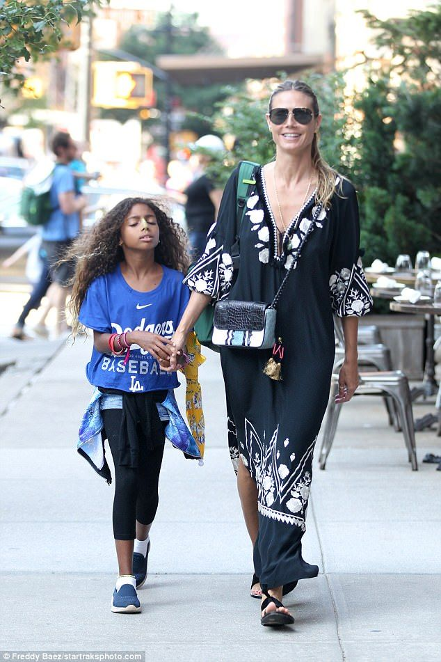 Mother and child: Heidi Klum held hands with her seven-year-old daughter Lou - one of Heid...