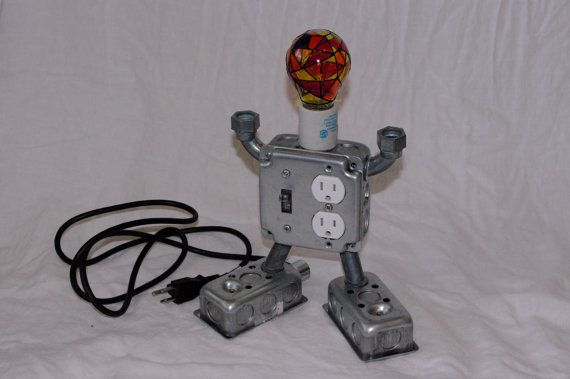 Whimsical industrial robot desktop charger by VVWoodWorking