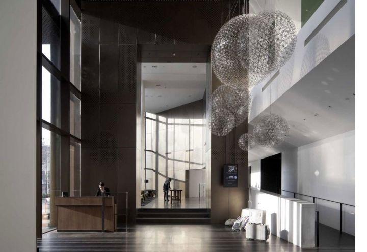 Grandi altezze e giochi di volume per l'ingresso della hall dell'hotel Le Mèridien a Zhengzhou DANDELION FLUFF LAMPS!