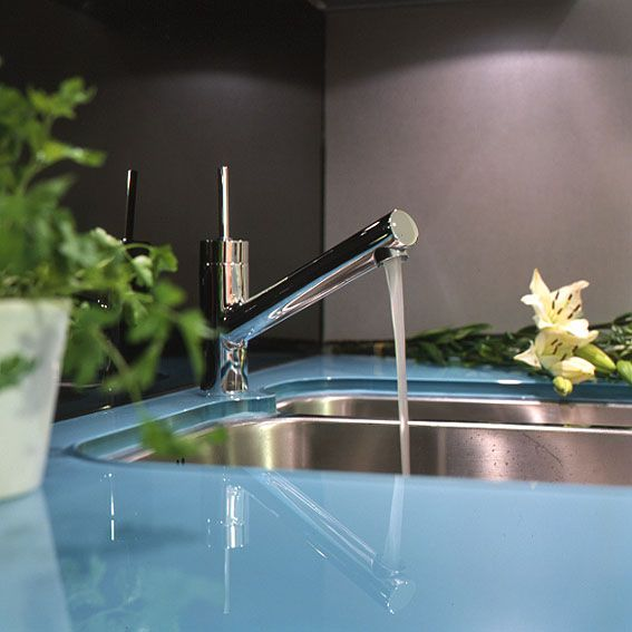 Lovely glass worktop and sink cover, complements a modern kitchen, can be made with matching splashback.