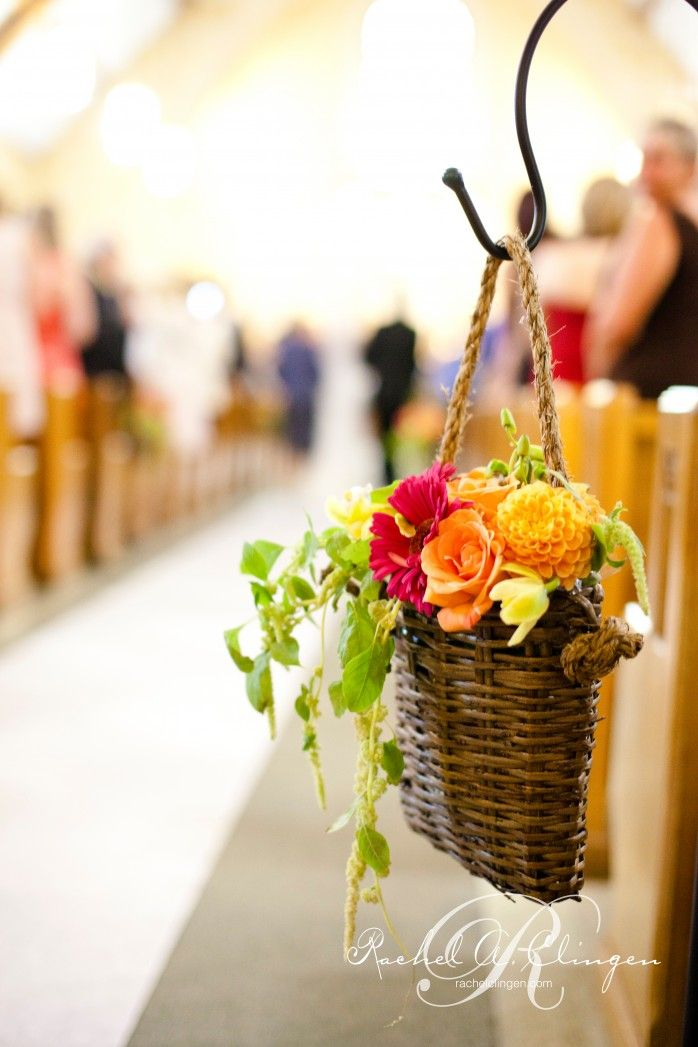 Wedding Ceremony Flowers. This would be cute to have a few flower arrangements in baskets like these at an outside wedding