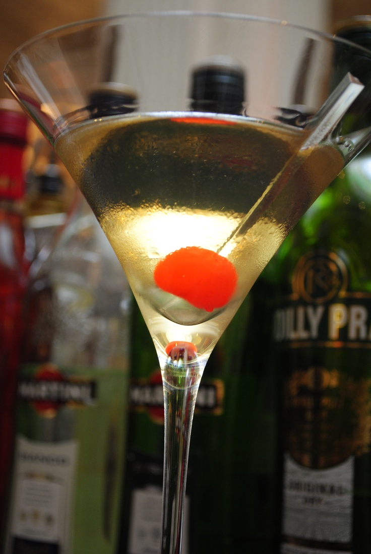 Silver Bulls Eye - Tanqueray & Black Pepper Infused Tanqueray Gin, Martini Extra Dry, Red Cherry -   Inspired by Reginald Brooks-King the British Archer who won the Silver Medal at the 1908 London Olympics