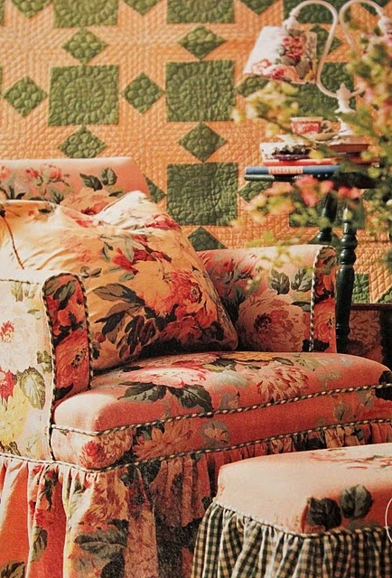 overstuffed chair with graphic quilt..and love the little ottoman.