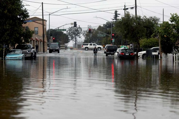 California storms:     A man walks through floodwaters on Feb. 20, 2017, in Salinas, Calif. Forecasters issued flash flood warnings Monday throughout the San  Francisco Bay Area and elsewhere in Northern California as downpours swelled creeks and rivers in the already soggy region.
