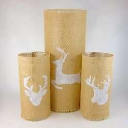 These stenciled burlap candleholders are easy to make and look beautiful lit.