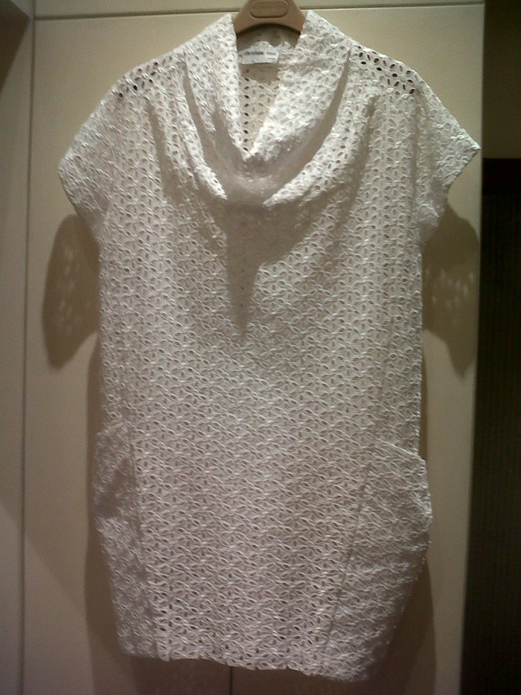 Christiane Ross tailor in Turin. precious blouse in white San Gallo embroidery and skirt black San Gallo embroidery