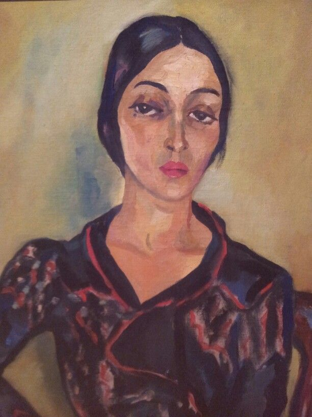 Irma Stern- the feeling this image expresses are mad, disappointed and stern. Her facial expressions, the way her eyebrows are placed and her mouth is in a straight line. Also I can see her hand is placed on her hip which made me think she was disappointed.