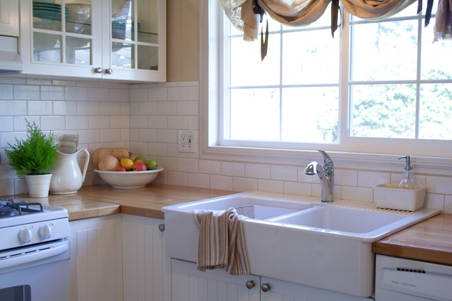 Apron front sink, butcher block, subway tile - what's not to love?!