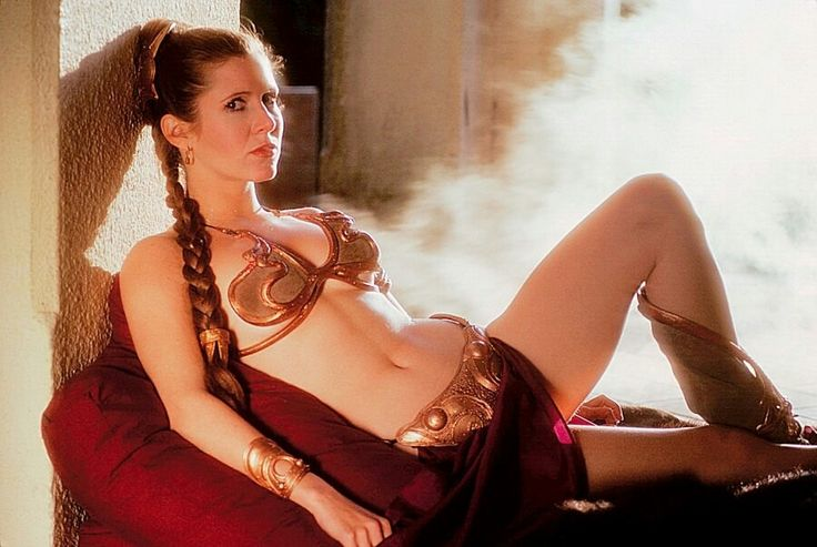 Princess Leia (Carrie Fisher) in Star Wars..what lil girl didnt want to be her, I know I did.