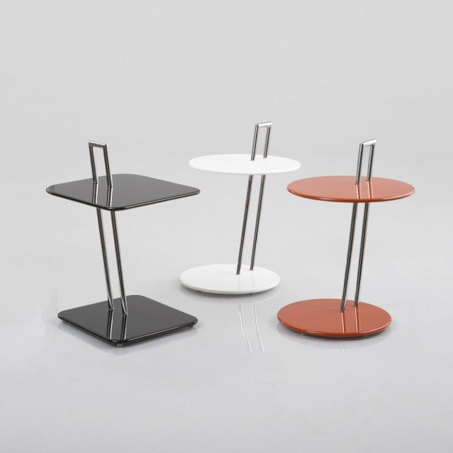 These are called Occasional Tables. I do not like how Eileen designed these tables because the steel frame sticking out of the top of the table looks unpleasing and it also takes up space on the surface.