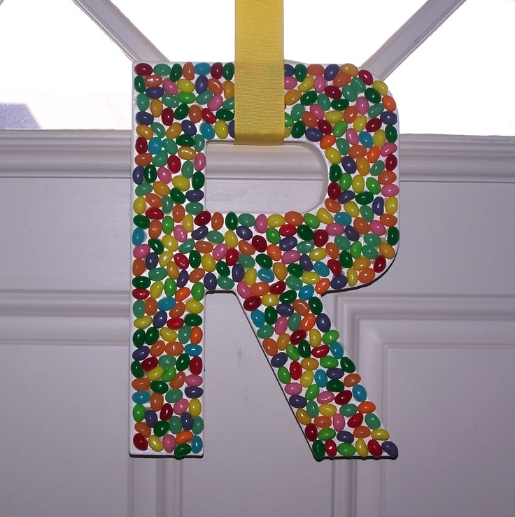 A fun (and yes, a little time consuming) decoration I made for our Easter celebration. I simply painted a cardboard letter I purchased at Joanne Fabrics and hot glued jelly beans to it. Original idea from Better Homes and Gardens