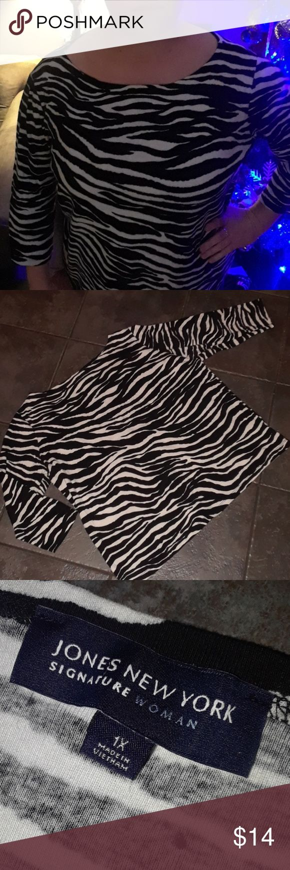 Woman's 1X Jones New York Zebra Print Top black Smoke Free and clean home!  Bundle up to 5lbs to get the most from your buck and save on shipping!  I have more woman's clothing along with Mens, boys, girls and infants.  Cheetah blouse tee shirt casual work office Many sizes.  S M L XL XXL Juniors Petite 6 7 8 9 10 12 14 16 Small Medium Large plus   🛍 Woman's black and white zebra animal print Top size 1X  JONES NEW YORK SIGNATURE WOMAN   100% Cotton 3/4 length sleeve Gently worn and is in…