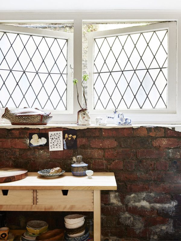 Kitchen detail.  Old cookbooks stolen from Ellie's Mum and op shops, postcards from the British Museum, Ikea bench. Photo – Eve Wilson, Production – Lucy Feagins / The Design Files.