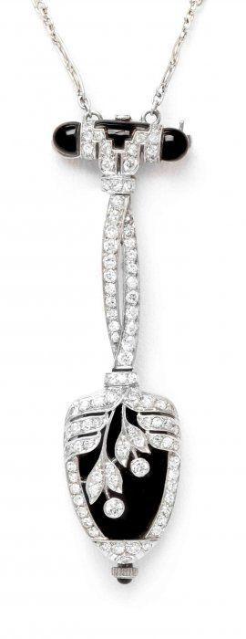 An Art Deco Platinum, Onyx and Diamond Watch Pendant, Audemars Piguet, signed AUDEMARS, PIGUET Co., entire pendant suspended from a filigree link platinum chain. Movement number: 32681.